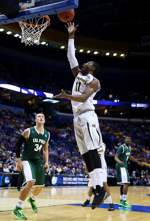 . Cleanthony Early #11 of the Wichita State Shockers takes a shot against the Cal Poly Mustangs during the second round of the 2014 NCAA Men\'s Basketball Tournament at the Scottrade Center on March 21, 2014 in St Louis, Missouri.  (Photo by Andy Lyons/Getty Images)