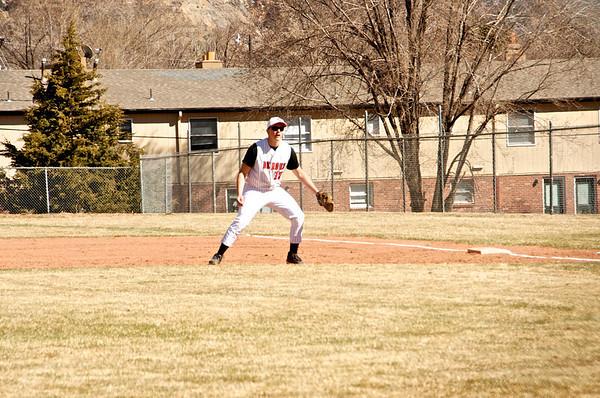 Collin playing baseball