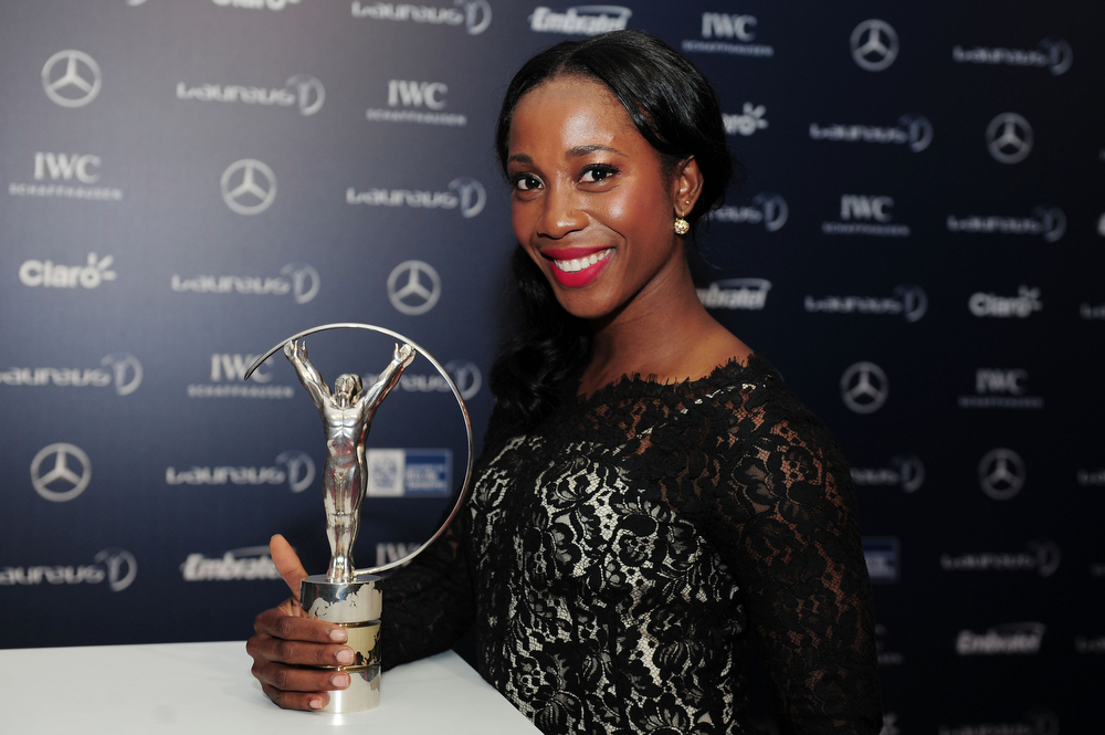 . Runner Shelly-Ann Fraser-Pryce poses with the trophy attends the 2013 Laureus World Sports Awards at the Theatro Municipal Do Rio de Janeiro on March 11, 2013 in Rio de Janeiro, Brazil.  (Photo by Jamie McDonald/Getty Images For Laureus)