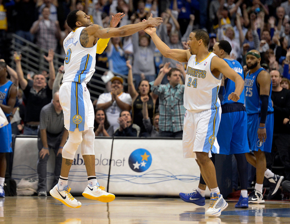 . DENVER, CO. - APRIL 04: Andre Miller (24) of the Denver Nuggets celebrates high fives Andre Iguodala (9) of the Denver Nuggets after hitting the game winning shot over Vince Carter (25) of the Dallas Mavericks with 2.8 seconds in the game April 4,  2013 at Pepsi Center. The Denver Nuggets defeated the Dallas Mavericks 95-94. (Photo By John Leyba/The Denver Post)