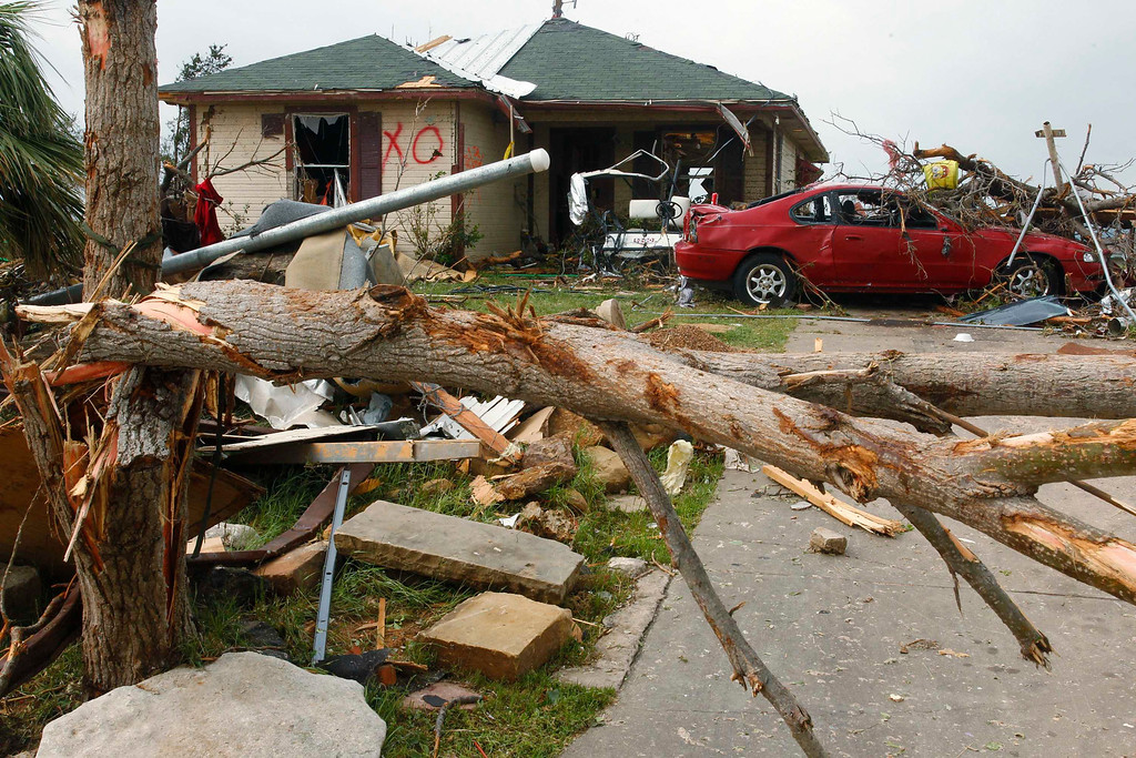 . A damaged home and car remain May 16 after tornados swept through the town of Granbury, Texas late May 15, 2013. REUTERS/Richard Rodriguez