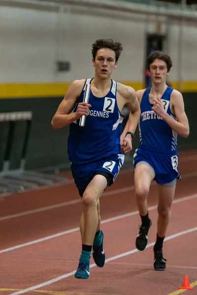 Junior Ben Huston in the final leg of the 4x800 relay. VUHS takes home first place while setting an event record with a time of 8:42.92 in the Boys 4x800 relay. Vermont Division II Indoor Track State Championships - UVM Gutterson Field House - 2/16/2020