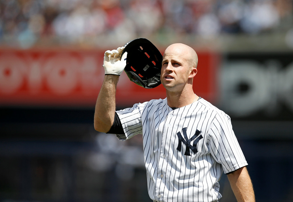 . New York Yankees left fielder Brett Gardner removes his helmet after grounding into a third-inning double play in a baseball game against the Detroit Tigers at Yankee Stadium in New York, Thursday, Aug. 7, 2014.  (AP Photo/Kathy Willens)
