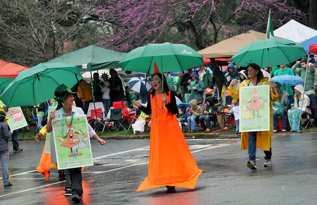 . A woman wearing an orange cone costume makes her way down the street during Savannah\'s 190-year-old St. Patrickís Day parade, Monday, March 17, 2014, in Savannah, Ga. (AP Photo/The Morning News, Richard Burkhart)