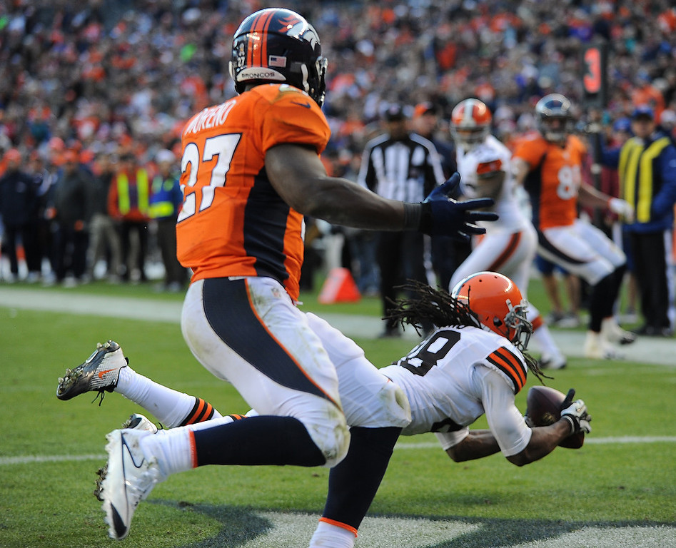 . Cleveland Browns free safety Usama Young (28) catches a pass from Denver Broncos quarterback Peyton Manning (18) for an interception, during the second quarter. The Denver Broncos vs Cleveland Browns at Sports Authority Field Sunday December 23, 2012. Tim Rasmussen, The Denver Post