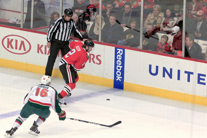 Duncan Keith winds up for a slap shot from the blue line.