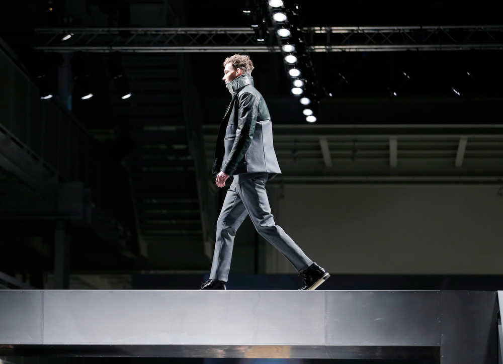 Description of . A model wears a creation for Fendi men's Fall-Winter 2013-14 collection, part of the Milan Fashion Week, unveiled in Milan, Italy, Monday, Jan. 14, 2013. (AP Photo/Antonio Calanni)