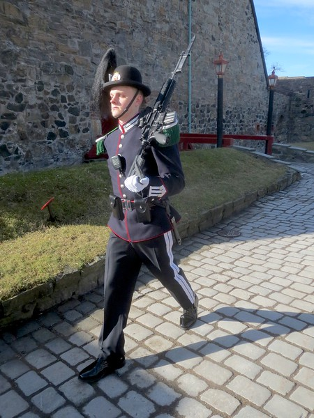 A guard patrolling the entrance to Akershus Fortress. I don't think they're allowed to smile. I think it's a job description.