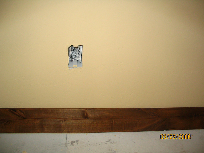 The rooms that will be carpeted get baseboard; those that get tiled get none. This is the master bedroom.