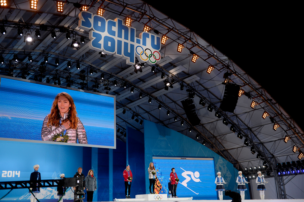 Description of . American Mikaela Shiffrin holds her hand over her heart and sing the National Anthem after being named the gold medalist as Austrian silver medalist Marlies Schild (left) and Austrian bronze medalist Kathrin Zettel flank her on the podium during the ladies' slalom medals ceremony. Sochi 2014 Winter Olympics on Friday, February 22, 2014 at Sochi Olympic Park. (Photo by AAron Ontiveroz/ The Denver Post)