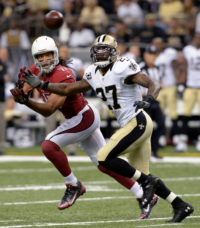 . New Orleans Saints free safety Malcolm Jenkins (27) breaks up a pass intended for Arizona Cardinals wide receiver Larry Fitzgerald (11) in the second half of an NFL football game in New Orleans, Sunday, Sept. 22, 2013. (AP Photo/Bill Feig)