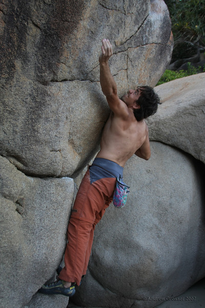 Trent on the crux move, an unknown V3 at Magnetci Island. The best bouldering problem he has ever hoped on. Photo by Andrew Grosser