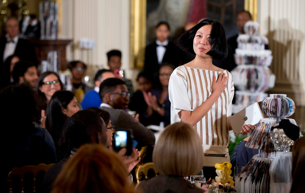 . Chelsea Chen, who won a design competition, acknowledges the introduction of first lady Michelle Obama, Wednesday, Oct. 8, 2014, during the Fashion Education Workshop at the White House in Washington.  (AP Photo/Manuel Balce Ceneta)