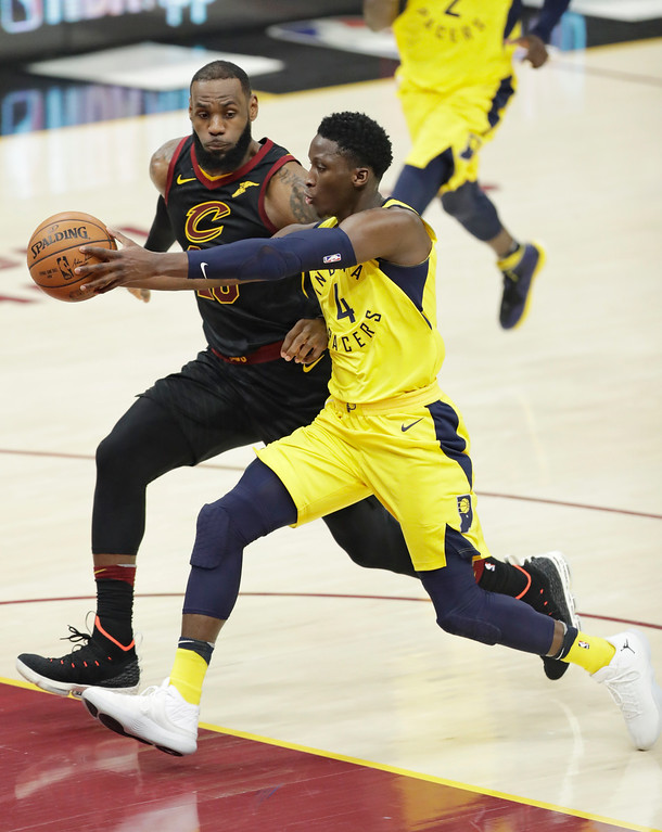 . Indiana Pacers\' Victor Oladipo (4) drives against Cleveland Cavaliers\' LeBron James (23) in the second half of Game 2 of an NBA basketball first-round playoff series, Wednesday, April 18, 2018, in Cleveland. The Cavaliers won 100-97. (AP Photo/Tony Dejak)