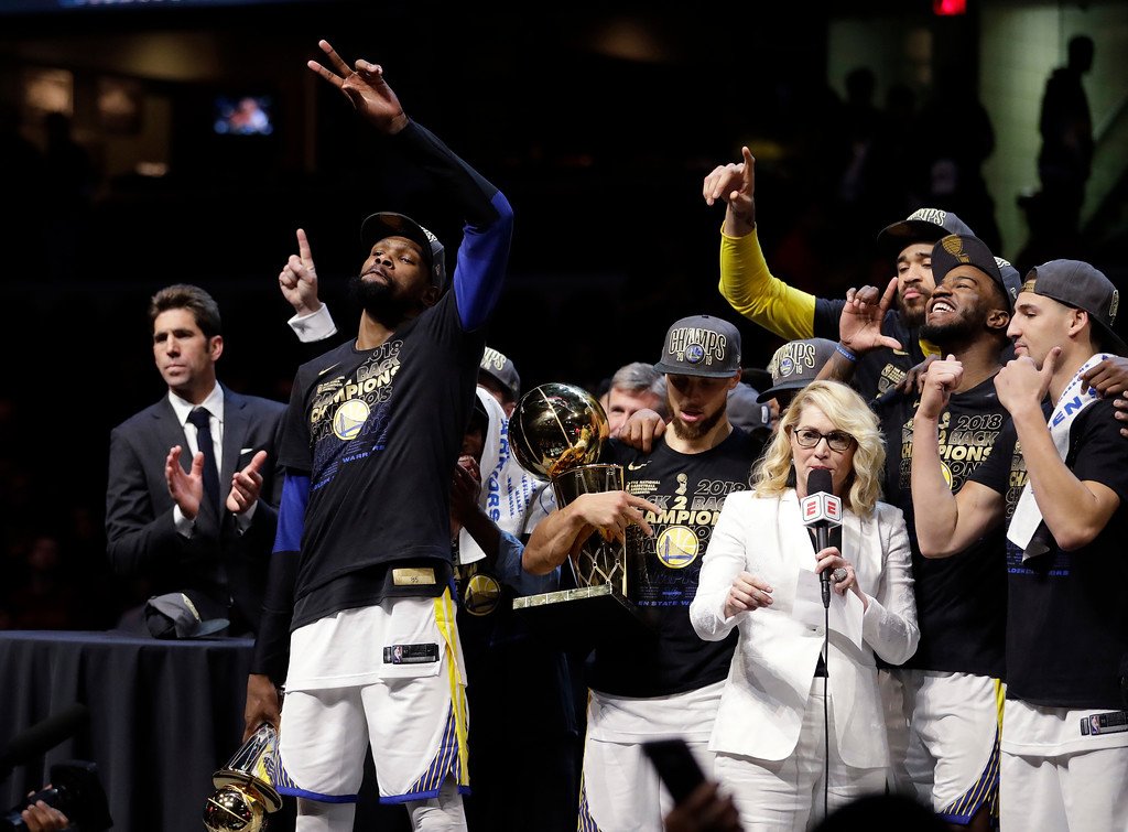 . Golden State Warriors\' Kevin Durant, left, celebrates after the Warriors defeated the Cleveland Cavaliers 108-85 in Game 4 of basketball\'s NBA Finals to win the NBA championship, Friday, June 8, 2018, in Cleveland. (AP Photo/Tony Dejak)