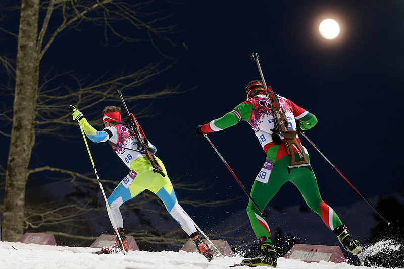 . Slovenia\'s Peter Dokl, left, and Belarus\' Evgeny Abramenko compete during the men\'s biathlon 20k individual race at the 2014 Winter Olympics, Thursday, Feb. 13, 2014, in Krasnaya Polyana, Russia. (AP Photo/Jae C. Hong)
