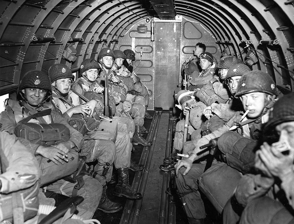 Description of . American Paratroopers fly over the English Channel enroute to play a key role in the invasion of France, June 6, 1944, by landing along a 100 mile front of the Normandy coast. (AP Photo/U.S. SIgnal Corps, Handout)