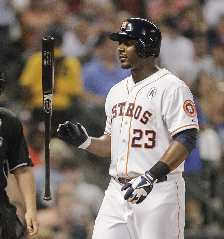 . Chris Carter #23 of the  Houston Astros tosses his bat after striking out in the fourth inning against the Texas Rangers on Opening Day at Minute Maid Park on March 31, 2013 in Houston, Texas.  (Photo by Bob Levey/Getty Images)