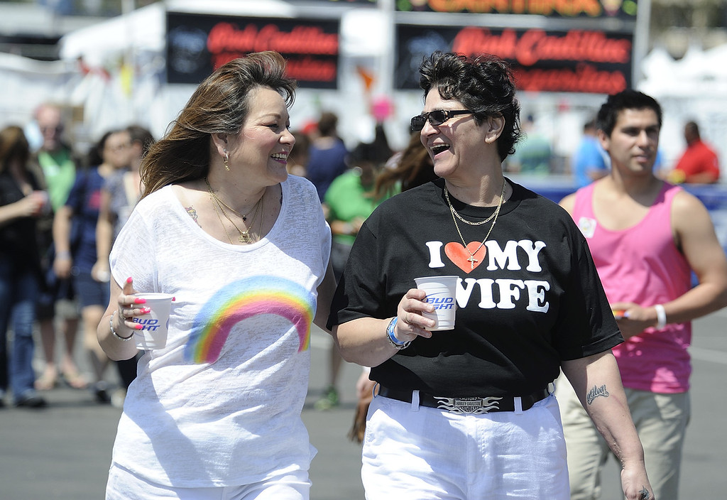 . LONG BEACH, CALIF. USA --  Aileen Galindo, left, and her wife, Rose Montoya share a laugh during the 30th annual Long Beach (Calif.) Lesbian & Gay Pride celebration Saturday, May 18, 2013. Photo by Jeff Gritchen / Los Angeles Newspaper Group