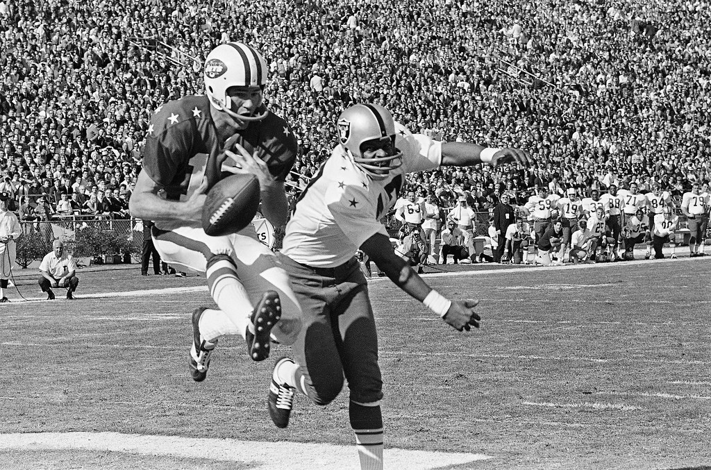 . East All-Star flanker Don Maynard (13) goes high in the air only to lose a pass in the end zone from East quarterback Joe Namath, both of the New York Jets in the AFL, All-Star game in Jacksonville, Fla., Jan. 21, 1968. Breaking up the pass is West All-Star back from Kansas City Johnny Robinson (42). (AP Photo)