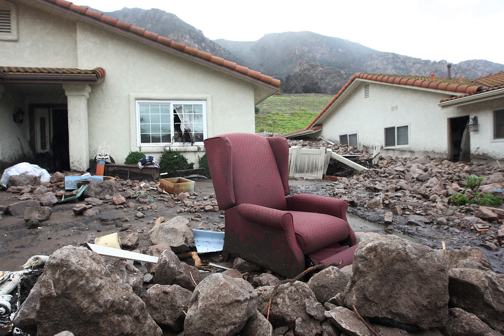 . Furniture is seen outside homes that were smashed by debris flows as a powerful storm that has been lashing northern California moves southward on December 12, 2014 in Camarillo Springs neighborhood of Camarilla, California.  (Photo by David McNew/Getty Images)