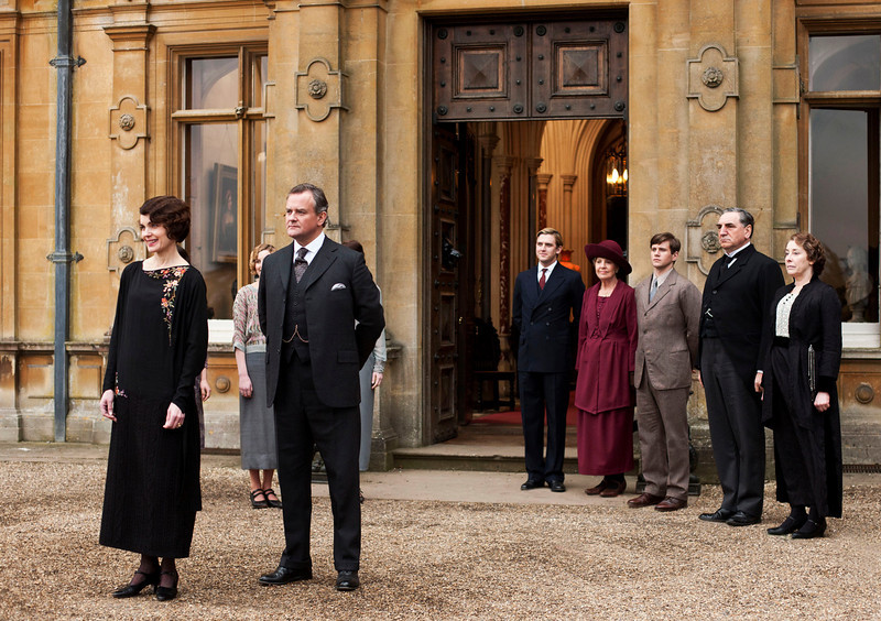 ". This undated publicity photo provided by PBS shows, from left, Elizabeth McGovern as Lady Grantham, Hugh Bonneville as Lord Grantham, Dan Stevens as Matthew Crawley, Penelope Wilton as Isobel Crawley, Allen Leech as Tom Branson, Jim Carter as Mr. Carson, and Phyllis Logan as Mrs. Hughes, from the TV series, ""Downton Abbey.\""  The program was nominated for an Emmy Award for outstanding drama series on, Thursday July 18, 2013. The Academy of Television Arts & Sciences\' Emmy ceremony will be hosted by Neil Patrick Harris. It will air Sept. 22 on CBS. (AP Photo/PBS, Carnival Film & Television Limited 2012 for MASTERPIECE, Nick Briggs)"