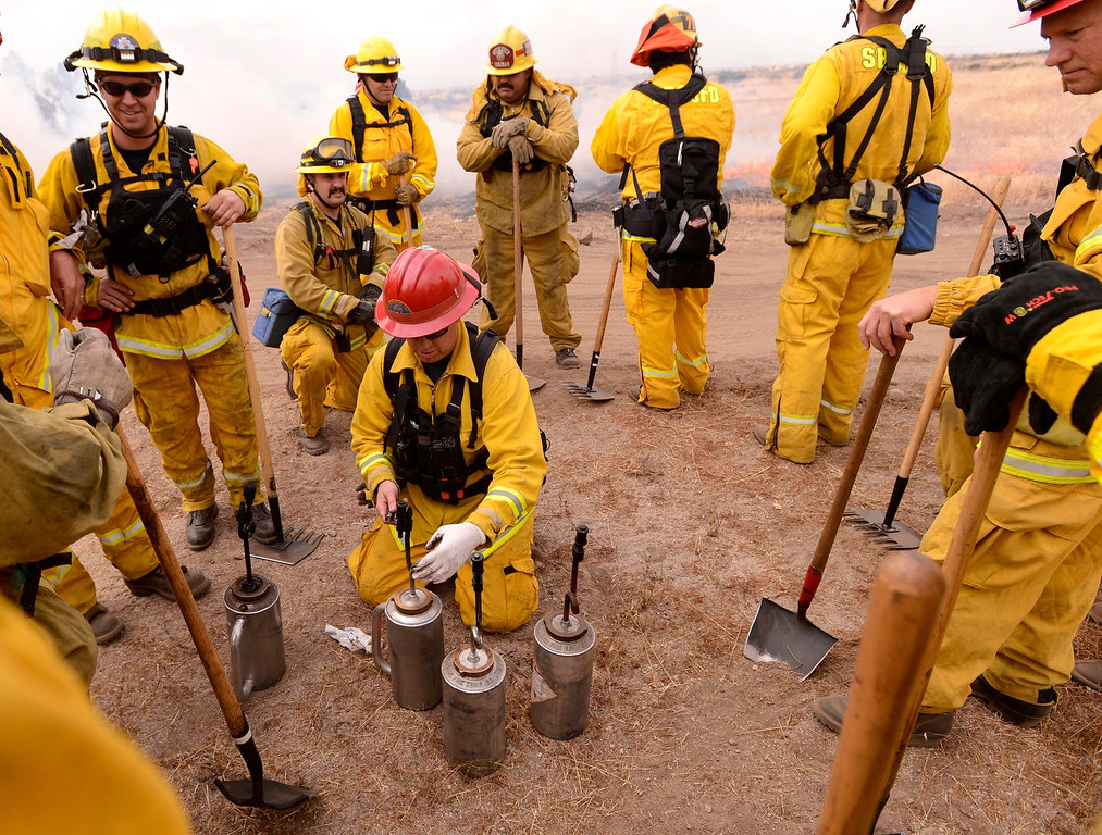 . Firefighters prepare to attack a training fire along Sierra Avenue north of Summit Avenue in North Fontana May 23, 2013.  GABRIEL LUIS ACOSTA/STAFF PHOTOGRAPHER.