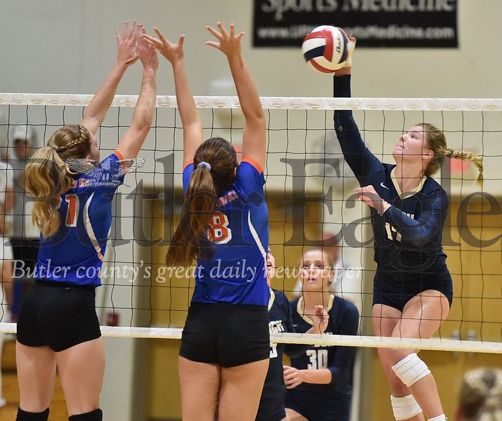 Knoch #17 Kennedy Christy spikes the ball at Armstrong #31 Loryn Bowser and #8 Taylor Claypoole in a  WPIAL 3A girls volleyball game at Knoch high school on Monday  September 17 , 2018..(Justin Guido photo)