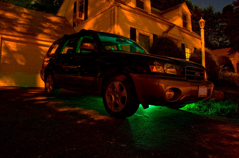My first attempt at light painting. This was taken using a wireless remote shutter release on bulb. I put a green filter on my SB600 flash and manually triggered it from behind the car a few times.