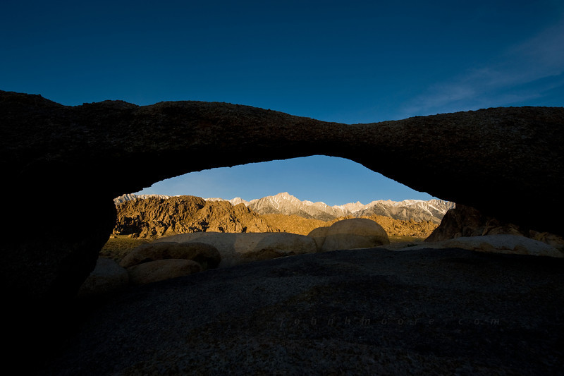 The Eastern Sierra Mountains viewed through Lathe Arch just after sunrise