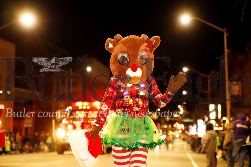 A lady reindeer waves to the crowd during Butler's Spirit of Christmas Parade Saturday. Seb Foltz/Butler Eagle