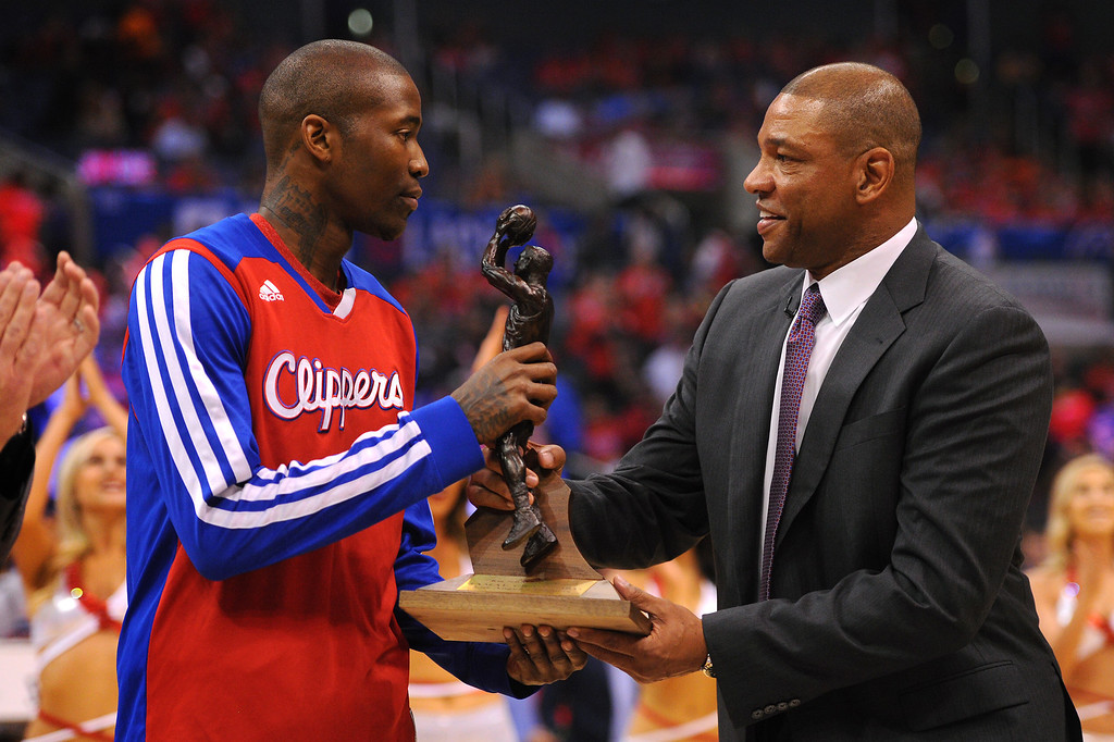 . The Clippers\' Jamal Crawford is presented the NBA Sixth Man of the Year Award by Clippers coach Doc Rivers before their playoff game against the Thunder, Friday, May 9, 2014, at Staples Center. (Photo by Michael Owen Baker/Los Angeles Daily News)