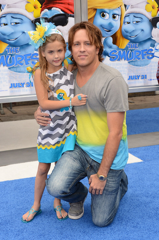 """. Dannielynn Marshall, left, and Larry Birkhead arrive at the world premiere of \""""The Smurfs 2\"""" at the Regency Village Theatre on Sunday, July 28, 2013 in Los Angeles. (Photo by Jordan Strauss/Invision/AP)"""