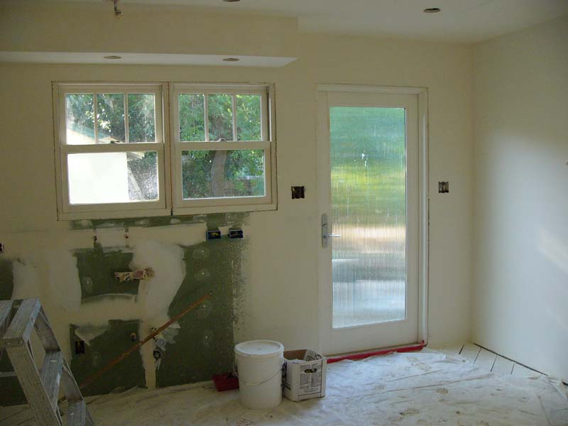 June 18th - Drywall floated and sanded.  Now we wait for it to dry completely before a prime coat of paint.  One week to cabinets!