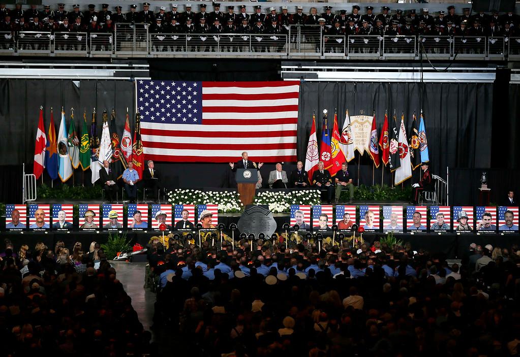 . U.S. Vice President Joe Biden speaks at a memorial service for the fallen members of the Granite Mountain Hotshots, in Prescott Valley, Arizona July 9, 2013.  REUTERS/Lucy Nicholson