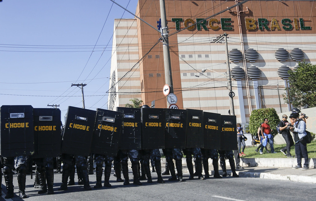 . Riot police are deployed during an anti-World Cup protest, on the morning the Brazilian mega-city hosts the tournament\'s opening match, in Sao Paulo on June 12, 2014.  AFP PHOTO / Miguel  Schincariol/AFP/Getty Images