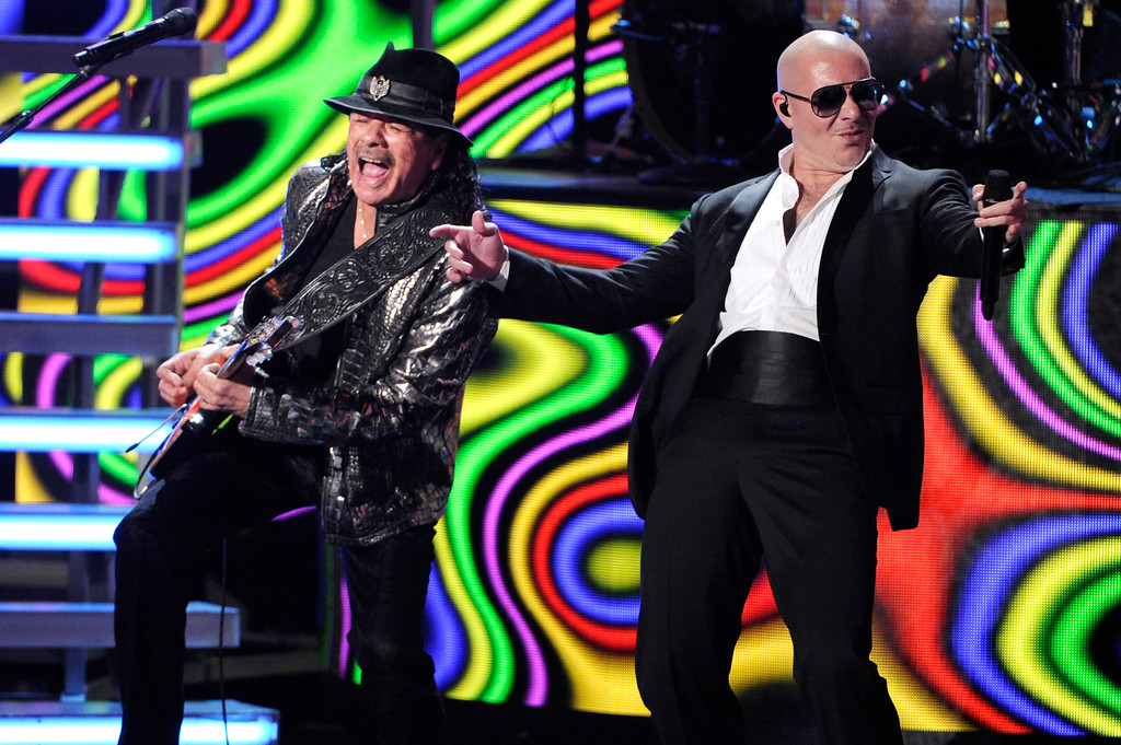 . Carlos Santana, left, and Pitbull  perform at the 15th annual Latin Grammy Awards at the MGM Grand Garden Arena on Thursday, Nov. 20, 2014, in Las Vegas. (Photo by Chris Pizzello/Invision/AP)
