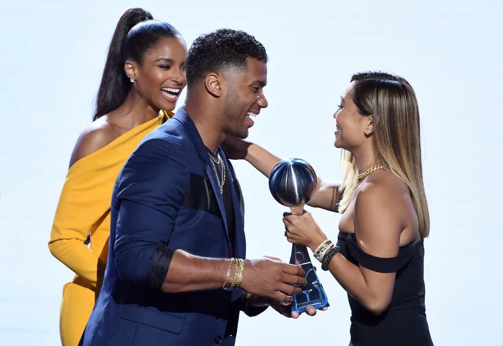 . Ciara, left, and Seattle Seahawks\' Russell Wilson present the award for best female athlete to snowboarder Chloe Kim, at the ESPY Awards at Microsoft Theater on Wednesday, July 18, 2018, in Los Angeles. (Photo by Phil McCarten/Invision/AP)