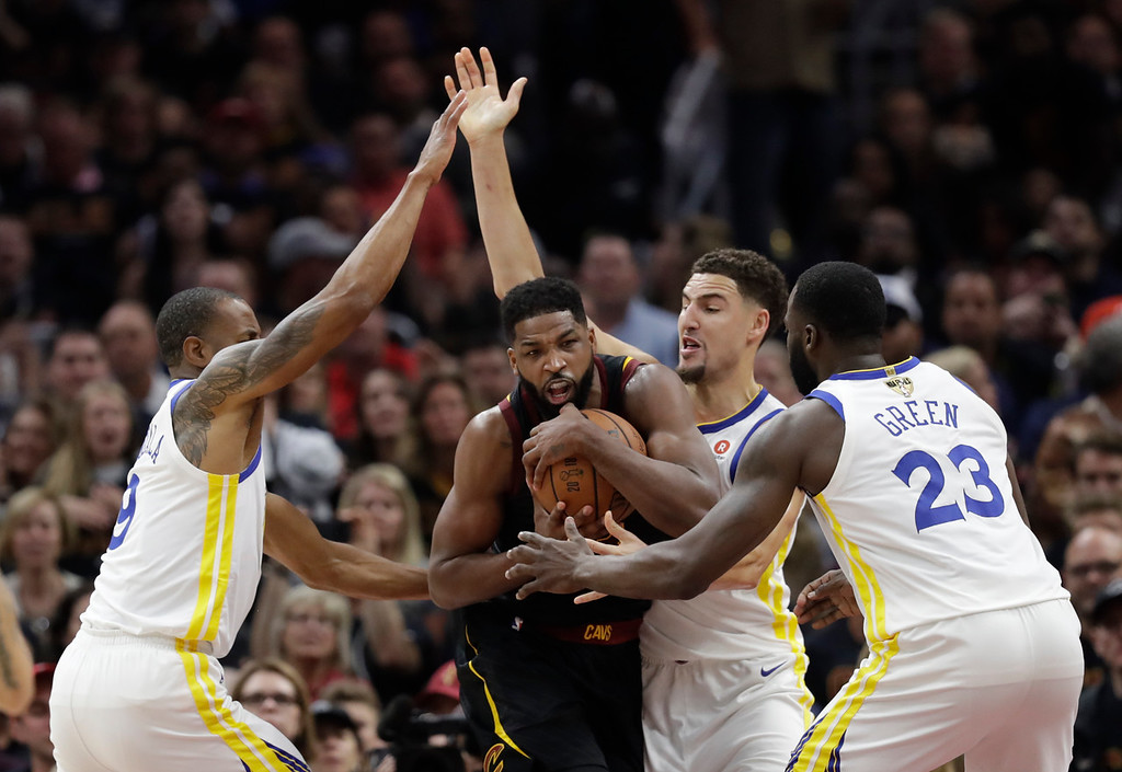 . Cleveland Cavaliers\' Tristan Thompson is defended by Golden State Warriors\' Andre Iguodala, left, Klay Thompson and Draymond Green, right, in the first half of Game 3 of basketball\'s NBA Finals, Wednesday, June 6, 2018, in Cleveland. (AP Photo/Tony Dejak)