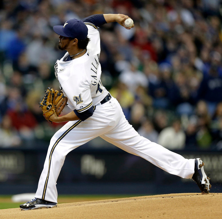. Milwaukee Brewers starting pitcher Yovani Gallardo throws to the Colorado Rockies in the first inning of an Opening Day baseball game  Monday, April 1, 2013, in Milwaukee. (AP Photo/Jeffrey Phelps)