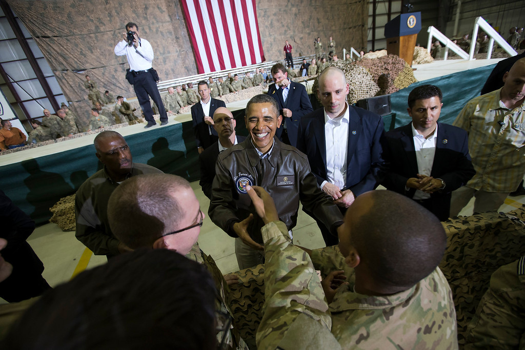 . President Barack Obama shakes hands at a troop rally at Bagram Air Field, north of Kabul, Afghanistan, during an unannounced visit, on Sunday, May 25, 2014. (AP Photo/ Evan Vucci)