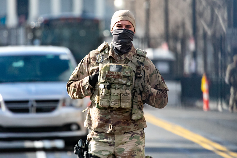 A National Guard member patrols near the east side of the Capitol as inauguration ceremonies conclude