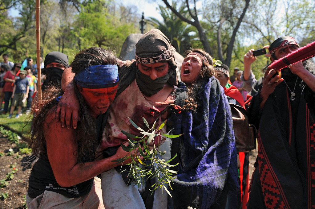 . Mapuche indigenous people make a performance during a protest for the commemoration of Columbus Day in downtown Santiago, on October 12, 2013. HECTOR RETAMAL/AFP/Getty Images