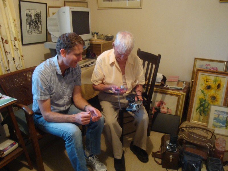 Noel and Audrey were award winning artists, and Noel was a pretty crack photographer. Here he's showing me his camera collection - the state of the art in his day. He's pretty amazed by Mum's small compact digital. He was thrilled by his first go at using one!
