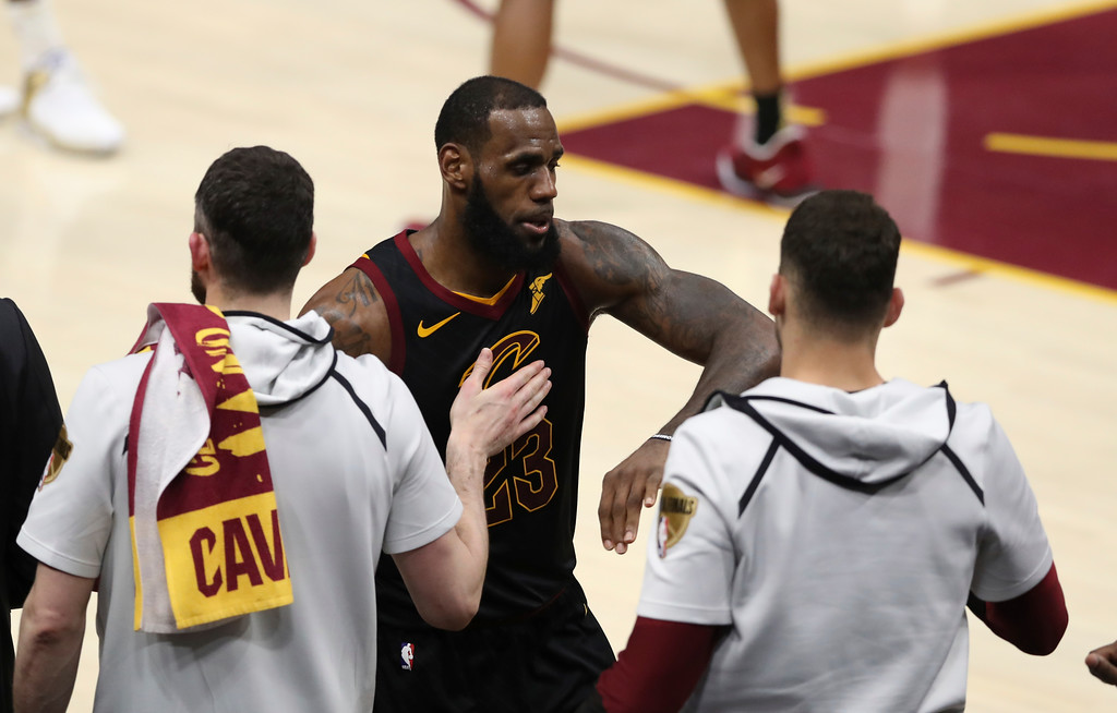 . Cleveland Cavaliers\' LeBron James greets teammates as he taken out in the second half of Game 4 of basketball\'s NBA Finals, Friday, June 8, 2018, in Cleveland. The Warriors defeated the Cavaliers 108-85. (AP Photo/Carlos Osorio)