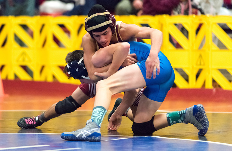 02/09/18  Wesley Bunnell   Staff  New Britain's Isahus Maldonado competes in the 106lb weight class during the Central Connecticut Conference Wrestling Tournament at Berlin High School on Friday night.