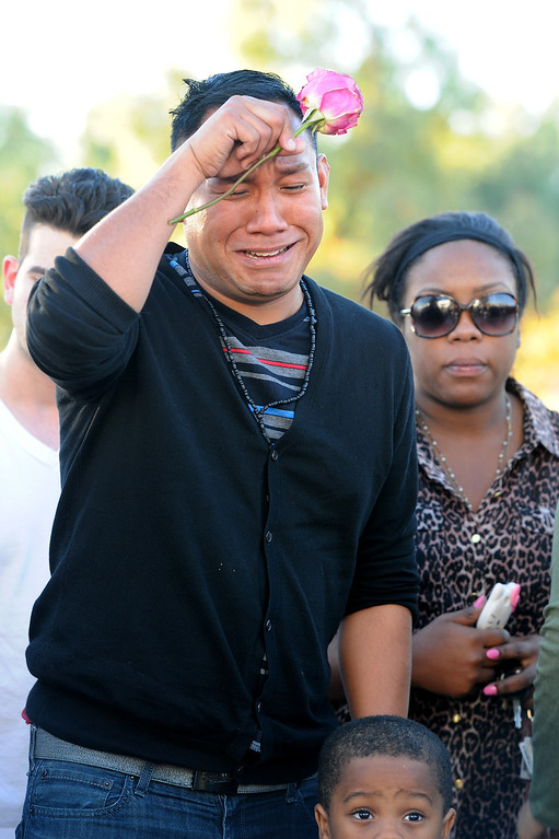 . Mychal Refuerzo grieves at a memorial for Paul Walker and Roger Rodas, Sunday, December 1, 2013, at the scene of their fatal crash site on Hercules Street near Kelly Johnson Parkway in Valencia. (Photo by Michael Owen Baker/L.A. Daily News)