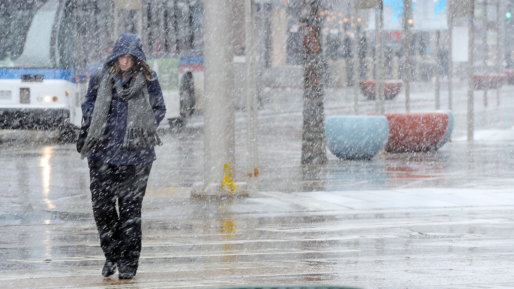 . DENVER, CO - FEBRUARY  25: Snow began to fall again  in the afternoon in Denver on Wednesday, February 25, 2015.  A walker is pounded by flakes as she walks across  Broadway at 16th Street in downtown Denver. (Photo by Cyrus McCrimmon/The Denver Post )