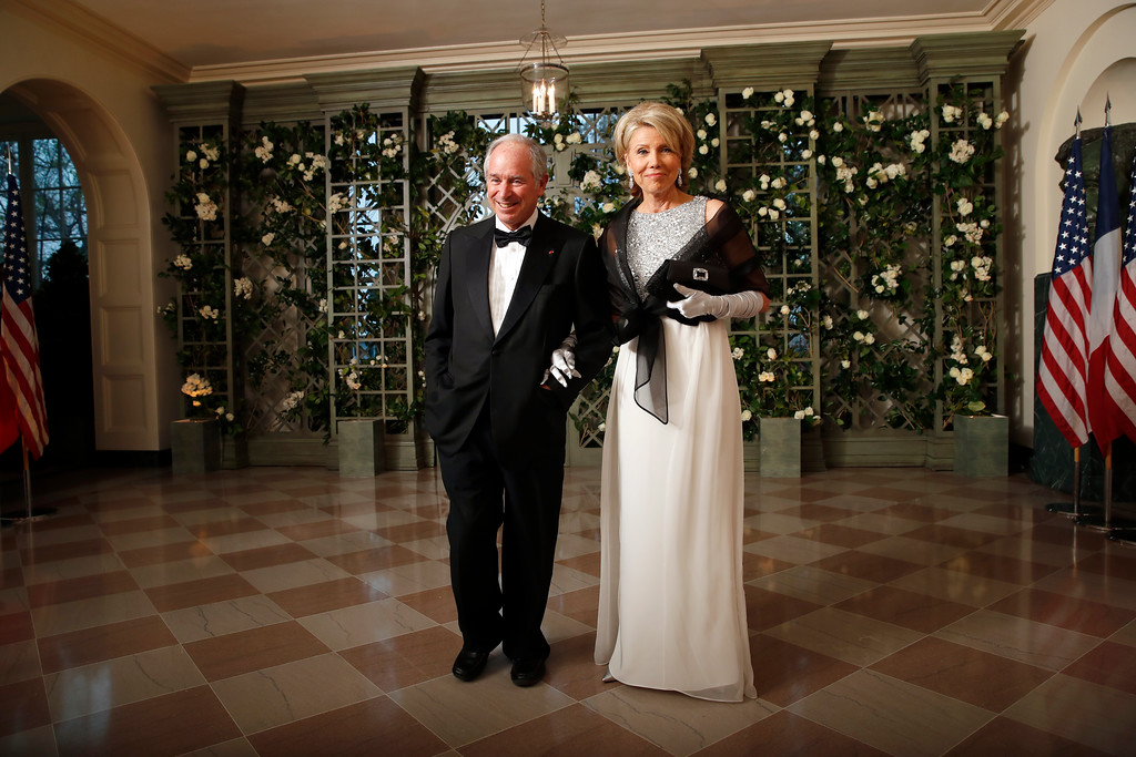 . Stephen Schwarzman and Christine Schwarzman arrive for a State Dinner with French President Emmanuel Macron and President Donald Trump at the White House, Tuesday, April 24, 2018, in Washington. (AP Photo/Alex Brandon)