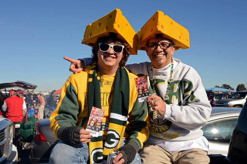 Description of . (L-R) Green Bay Packers fans Ruben Soto Jr. and Ruben Soto Sr. of Antioch, California pose prior to the NFC Divisional Playoff Game between the Green Bay Packers and the San Francisco 49ers at Candlestick Park on January 12, 2013 in San Francisco, California.  (Photo by Thearon W. Henderson/Getty Images)